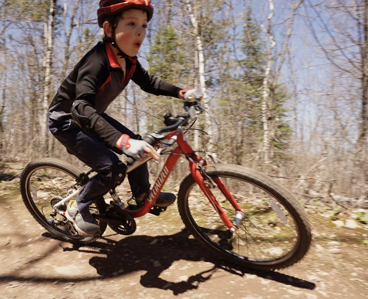 Fun, and fun berms, provide a good time for young and veteran riders alike.