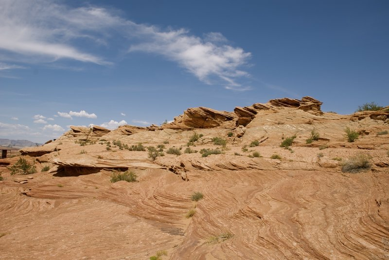 Stone formations rise above Lake Powell.