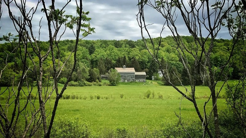 Stately old farm houses, sun-blanched barns, and peaceful pastureland line the D&H Rail Trail.
