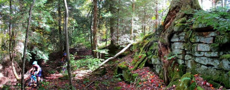 Riders pass a rock formation on the Fork Mountain Trail in early Fall. Photo by Mike Boyes.