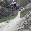 Shreddin' the jumps along Scott Canyon Trail.