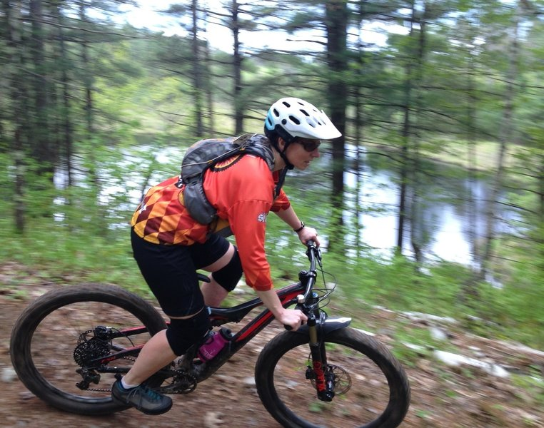 Carving Berms above a Glacial Pothole lake on the Danky Dank trail.