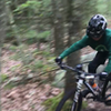 On this steep and rocky descending switchback on Camps Trail, it can help to flick around your back wheel.
