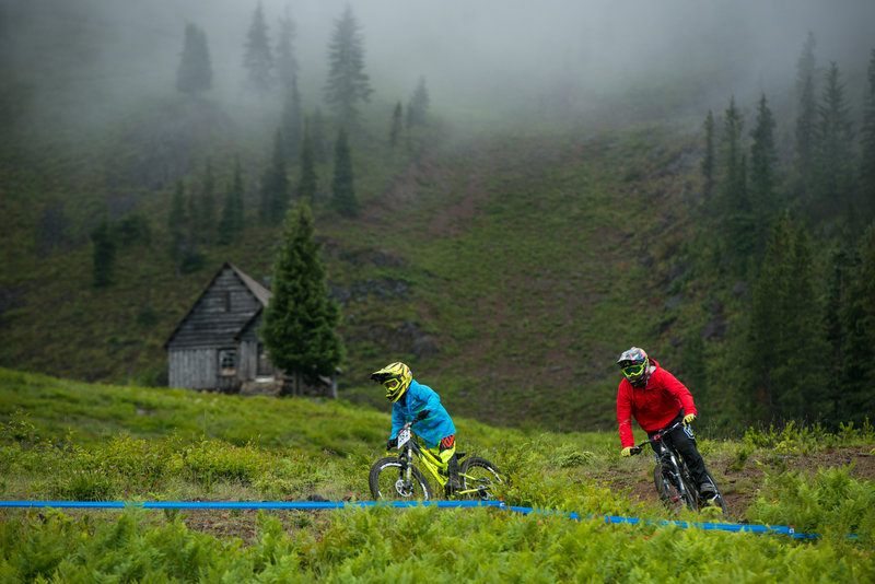 Riders descend below the Warming Hut on Gnar-Gnar on a raining morning.