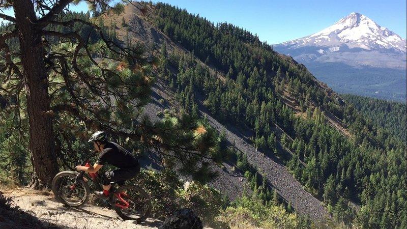 Flirting with gravity on the edge of Surveyor's Ridge.