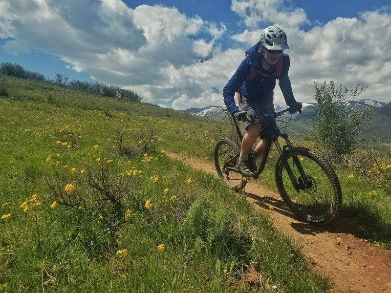 Spring riding only gets better when the wildflowers are out! Photo by Andrew Blackwell.