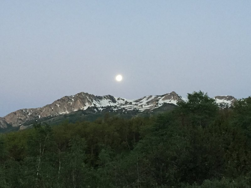 An early morning June moon over Snowbasin.