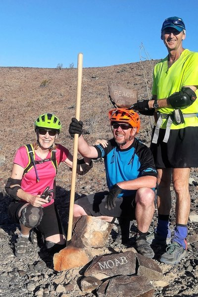 Placing a trail marker on Moab.
