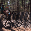 Riding the upper edge of a wall ride at Lindsey Park.