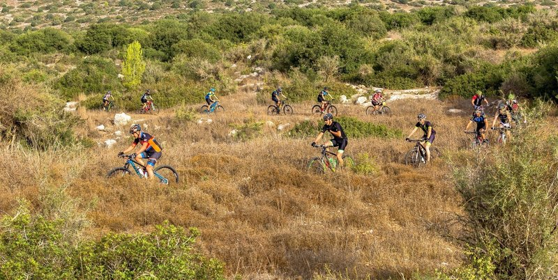 Riders climb a serpentine section of the Adulam Singletrack.