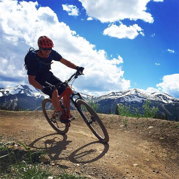 Enjoying the berms on Barney Flow with Breck in the background.