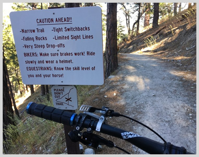The warning sight at the top of Lower Genoa Canyon Trail seems to cover all the basis for a rowdy descent.