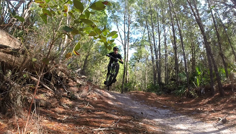Finding some air  on the Yellow West trail at Turkey Creek.