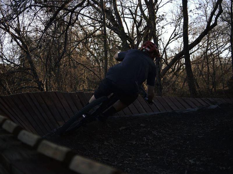 A rider rails a wooden corner at Binkley Park.