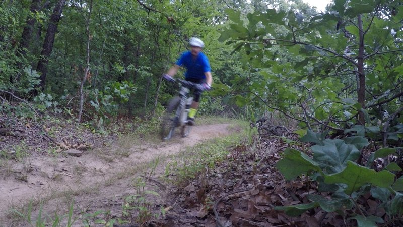 Gaining speed through a slightly rutted section.