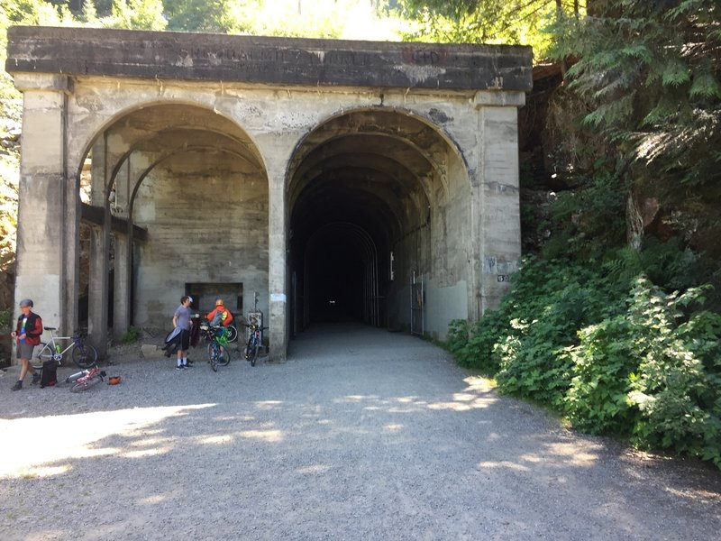 The exist of the Snoqualmie Tunnel.  A small cascading waterfall is off to the left.