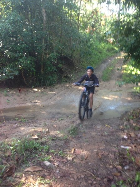 A fast downhill creek crossing which can have a lot of water in it at times.