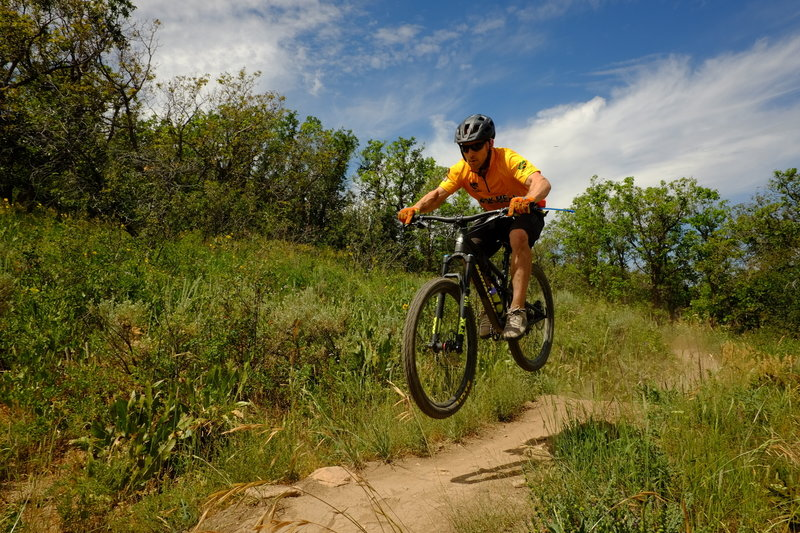 A local trail ambassador catches some air on NPR. Photo: Dave Epperson