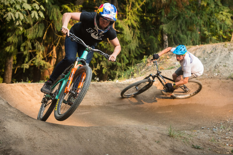 Jill Kintner and Lars Sternberg take an inaugural lap during the pumptrack's grand opening.