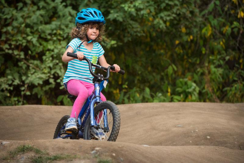 "A young rider circles the ""Grom"" pumptrack at Whatcom Falls Park."