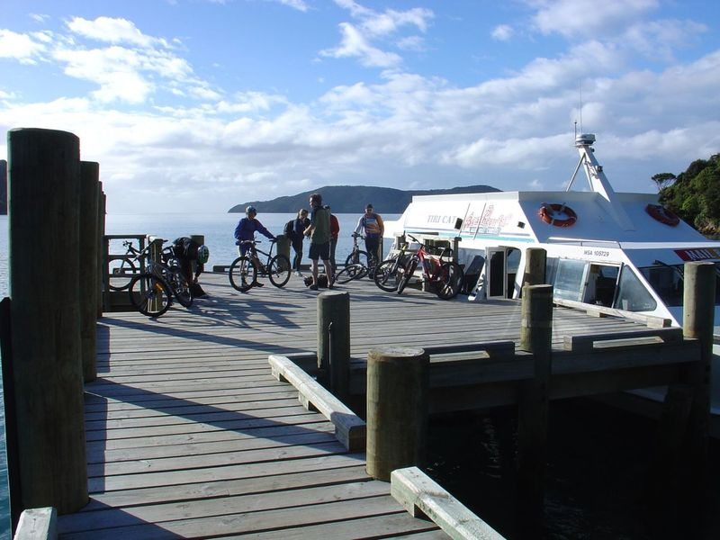 Unloading bikes off the water taxi at Ships Cove