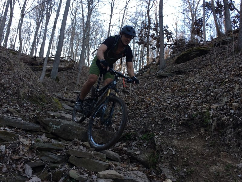 Steve Thorne, a local rider riding the rock garden known as Faceplant.