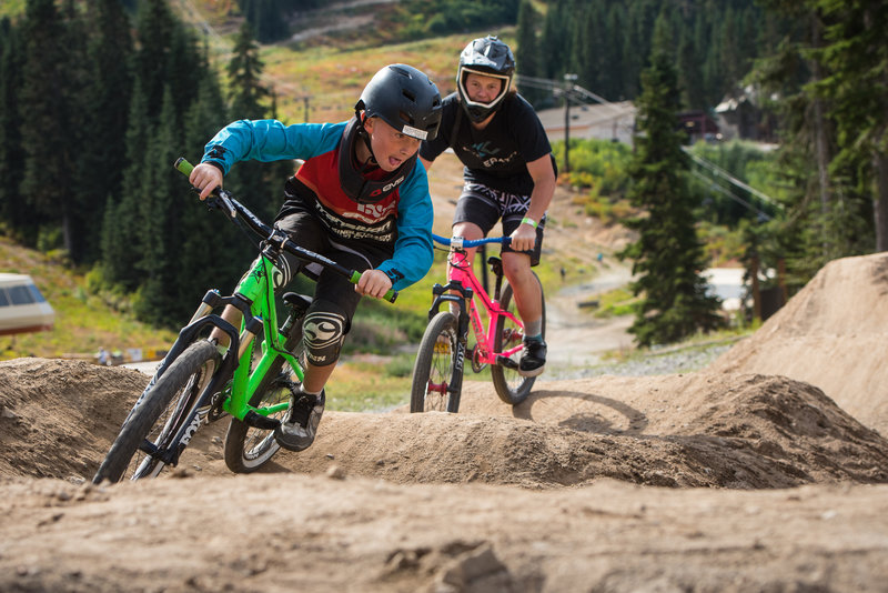 Riders take a break from the trails to enjoy Stevens Pass' pumptrack.