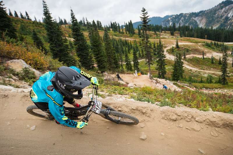 A rider makes his way down the slightly rocky berms on Rock Crusher.