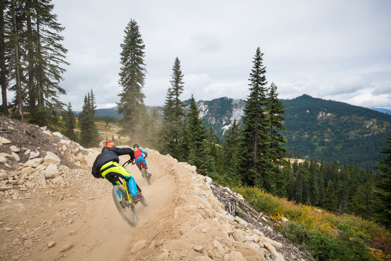 Fast berms and dusty turns. Riders enjoy Rock Crusher at Stevens Pass Bike Park.