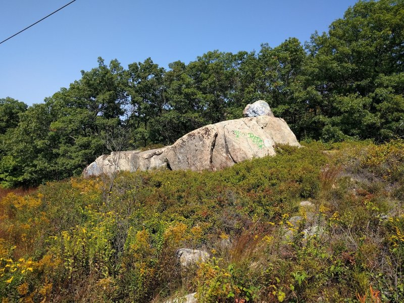 The iconic Lynn Woods boulder. People actually ride up and down this boulder block.