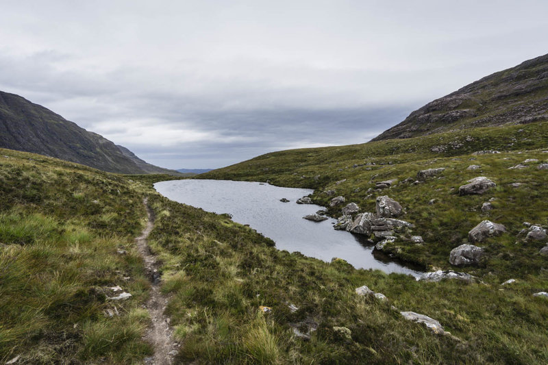 There is a small lochan in the Coire Roill Pass