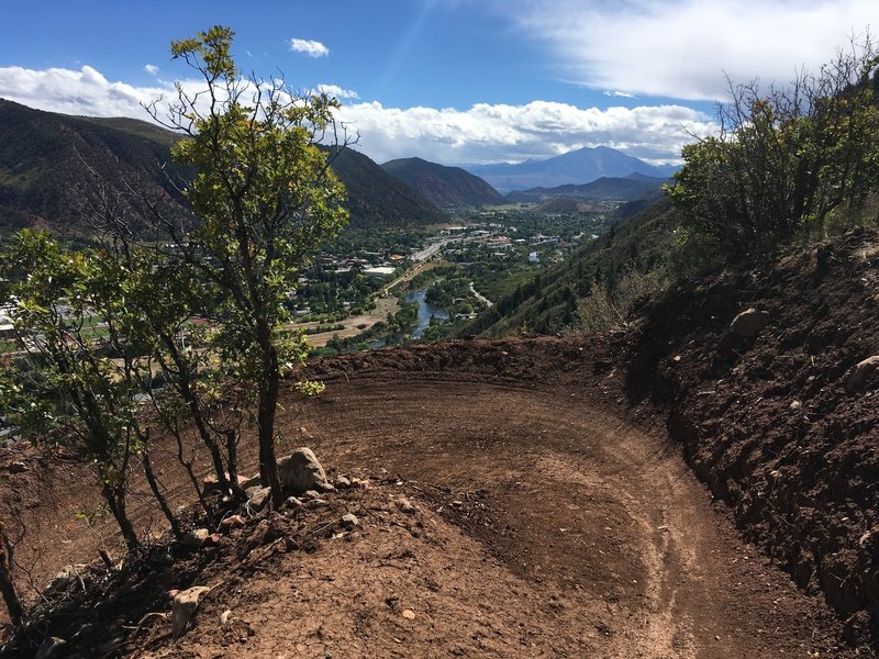 Fresh berm on lower middle Grandstaff Trail, with Roaring Fork River and Mount Sopris in the distance.