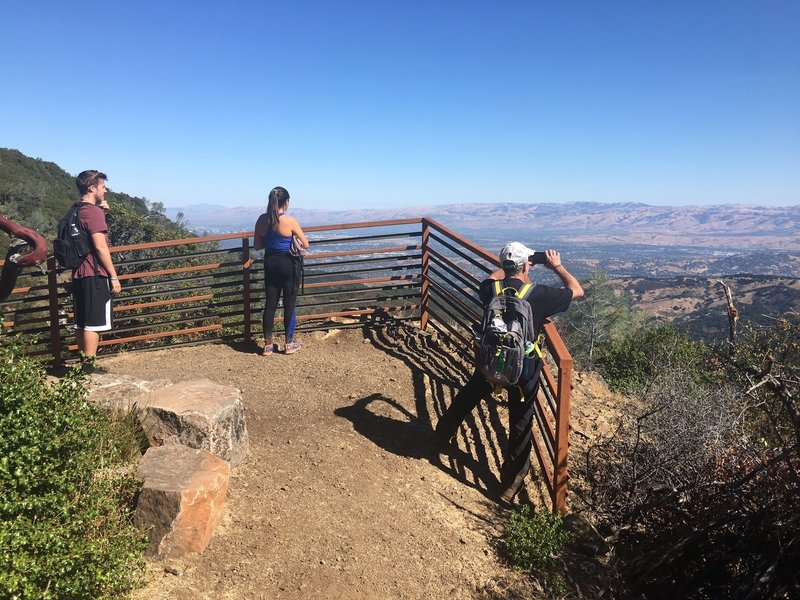 You'll find a mix of trail users enjoying the view from the Guadalupe Creek Overlook. Located on the Mount Umunhum Trail, 1.3 miles from the trailhead