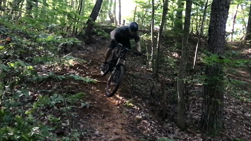 A left off the loop in to a gulley with drops, a berm, and some small jumps. Reconnects with main trail.