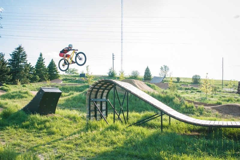 Jumping the wooden 'whale-tail' feature on the XL Slopestyle Line.