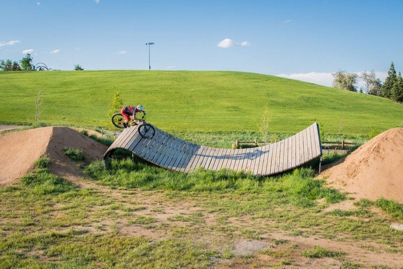 Jumping onto, and off of, a unique wooden feature on the XL Slopestyle Line.