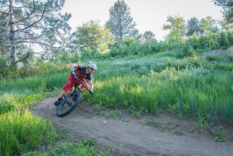 Riding one of the downhill singletrack switchbacks on the XC loop. Off-camber, loose over hardparck, FUN!