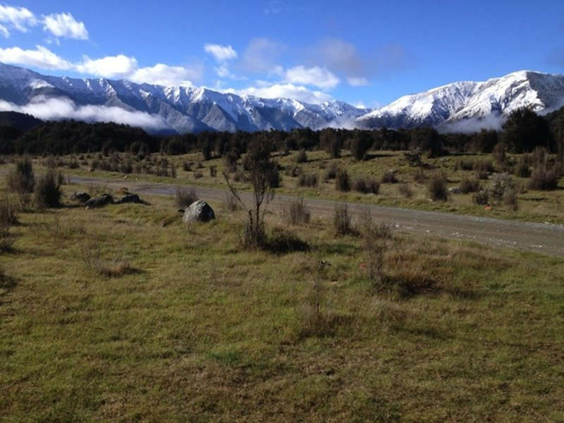 Winter snow caps the St Arnaud Range on the left and Mt Robert on the right