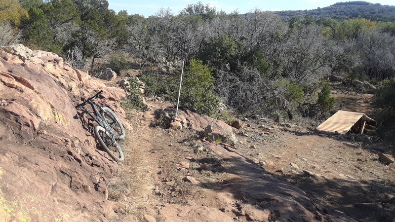 Texas Enduro Cup's JAWS drops off to the right and the Race Loop continues straight