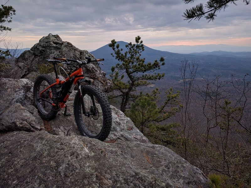 Fatty takes a rest while I capture Big House Mountain to the east (background). The climbing isn't finished; enjoy a bit of rest at these vista overlooks and regain your strength!!