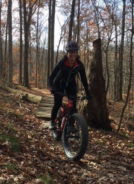 J crosses rustic skinny on Hesitation Point Trail.