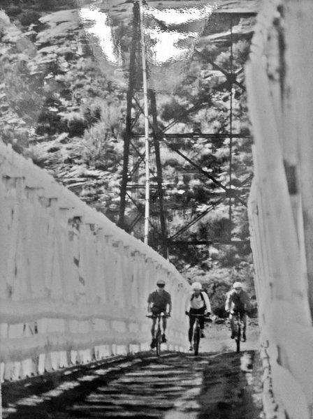 Crossing the Colorado River on the Dewey Bridge. Kokopelli's Trail,1993.
