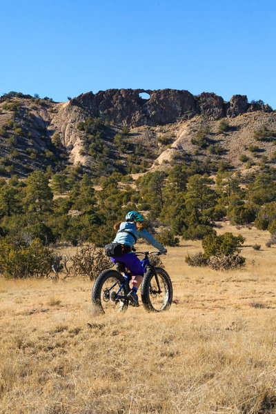After a flowy descent through a Juniper forest along the Lemitas Trail the terrain opens up into a broad meadow beneath Window Rock