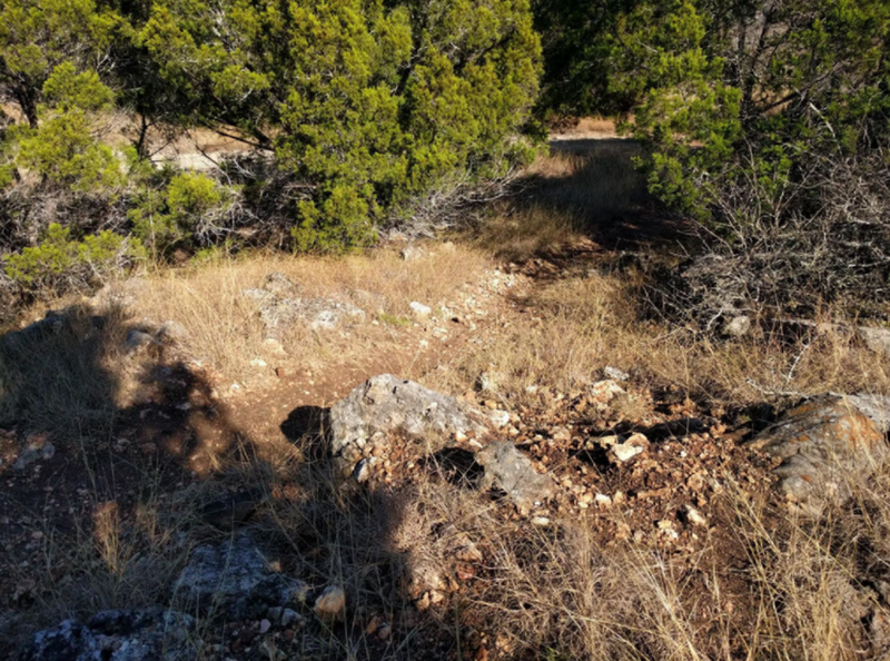 A rocky descent leading to a climb.