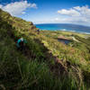 The trail meanders on a steep steep side slope overlooking the gorgeous turquoise Pacific Ocean.