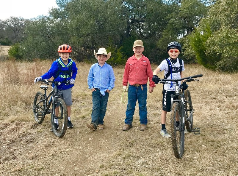 Mountain Bikers and Cowboys share the trail at Dripping Springs Ranch :)