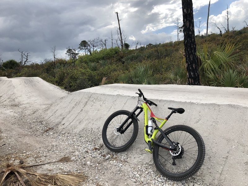short downhill jump section followed by fast berms