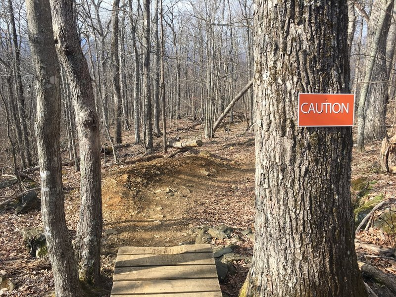 Drop off of bridge feature, caution signs are customary when approaching a drop or rock garden.