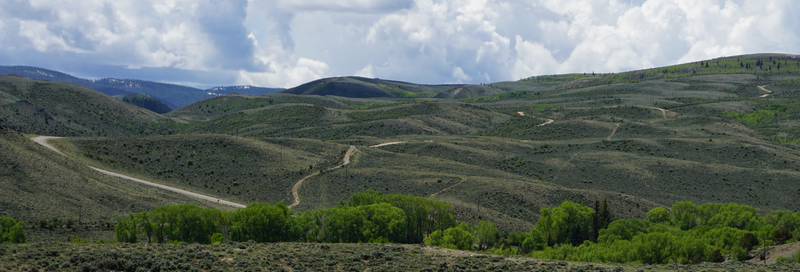 Finley Hill Road can be seen winding up the hills outside of Encampment.