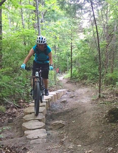 Rie rides stumpy alt line on Perimeter Trail